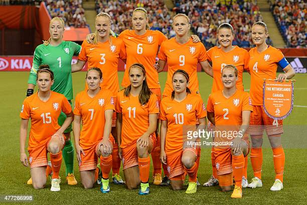The Netherlands players pose for a team photo during the 2015 FIFA Women's World Cup Group A match against Canada at Olympic Stadium on June 15 2015...