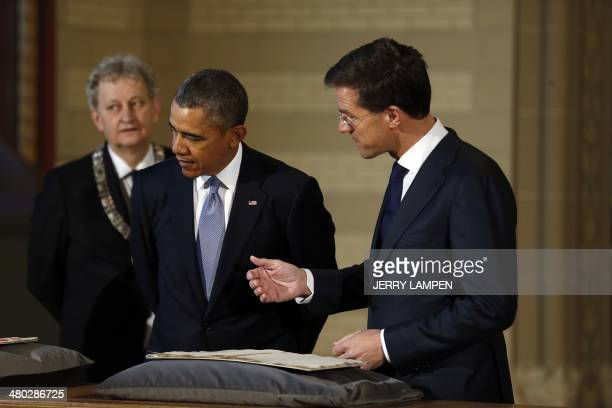 The Netherlands Prime Minister Mark Rutte, US President Barack Obama, and Amsterdam Mayor Eberhard van der Laan look at The Plakkaat, commonly known...