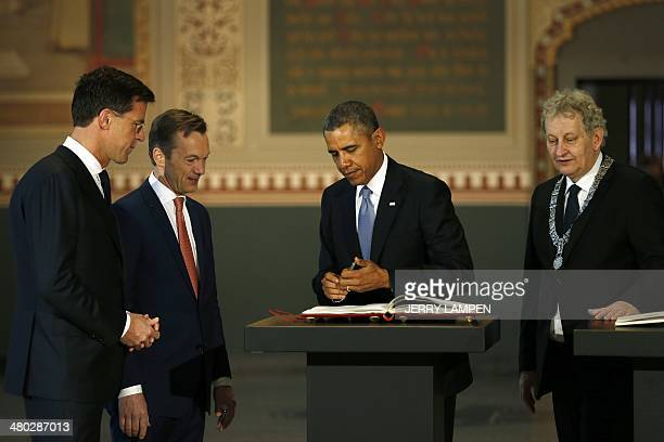 The Netherlands Prime Minister Mark Rutte , Wim Pijbes, Museum director, and the mayor of Amsterdam Eberhard van der Laan look at US president Barack...