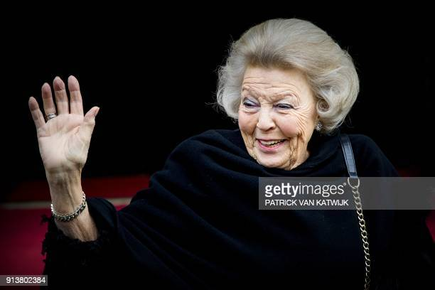 The Netherland's Princess Beatrix waves as she celebrates her 80th birthday with her friends and family in the palace on Dam Square in Amsterdam on...