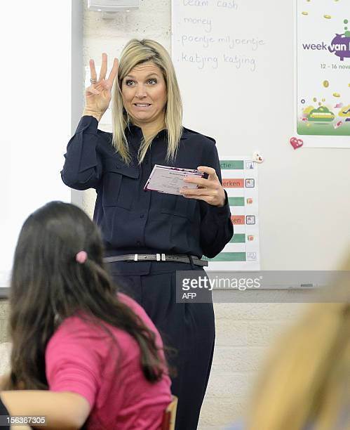 The Netherlands' Princess Maxima speaks to pupils of an elementary school in Zoetermeer on November 14 2012 during the 'Week van het geld' The...