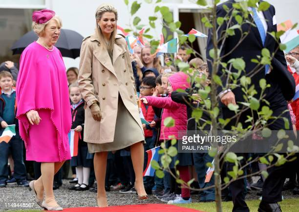 The Netherlands' Queen Maxima arrives to take part in a treeplanting ceremony at the Irish Presidential mansion in Pheonix Park in Dublin on June 12...