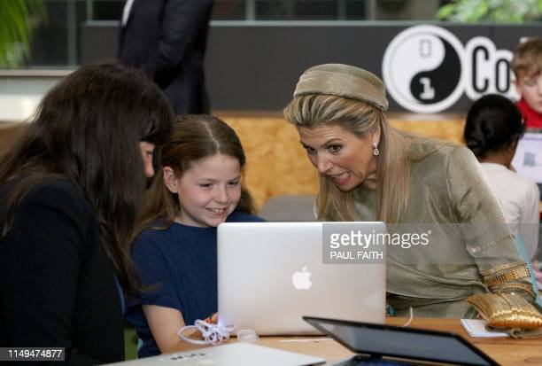 The Netherlands' Queen Maxima chats with kids at CoderDojo a global movement of free volunteerled communitybased computer programming clubs for young...