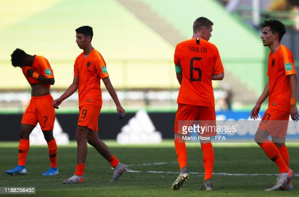 The Netherlands side cut dejected figures at the final whistle during the 3rd Place Playoff match between the Netherlands and France at the Estadio...