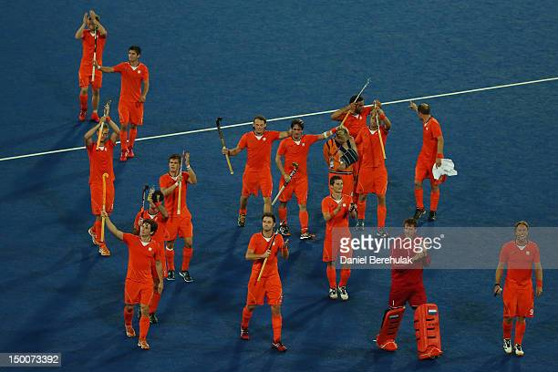The Netherlands team celebrate after the game during the Men's Hockey semifinal match between Great Britain and the Netherlands on Day 13 of the...