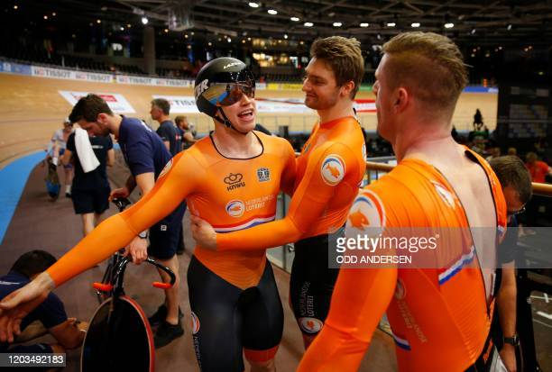The Netherlands team celebrate gold after the men's Team Sprint at the UCI track cycling World Championship in Berlin on February 26 2020