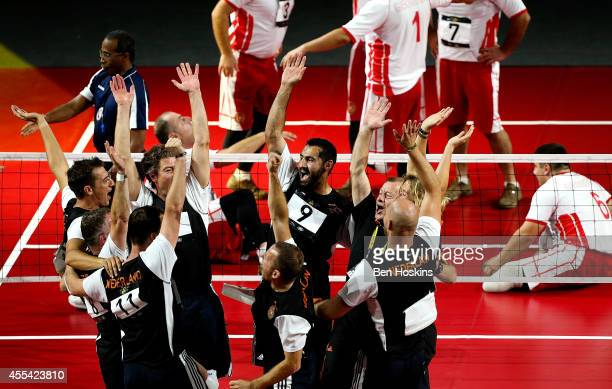 The Netherlands team celebrate winning the bronze medal match against Georgia during the Sitting Volleyball on day 4 of the Invictus Games at Olympic...