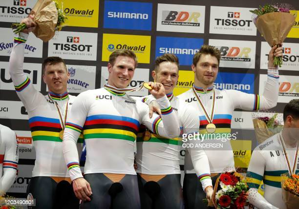 The Netherlands team celebrates Gold in the men's Team Sprint at the UCI track cycling World Championship in Berlin on February 26 2020