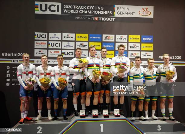 The Netherlands team celebrates Gold on the podium with the British and the Australian team after the men's Team Sprint at the UCI track cycling...