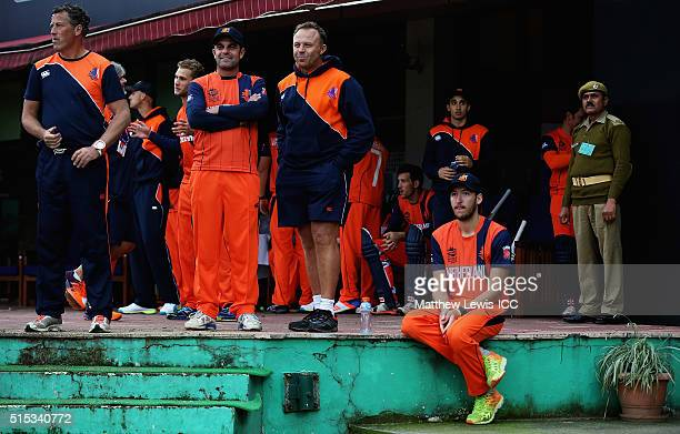The Netherlands team look on as rain delays the start of the ICC World Twenty20 India 2016 match between Netherlands and Ireland at the HPCA Stadium...
