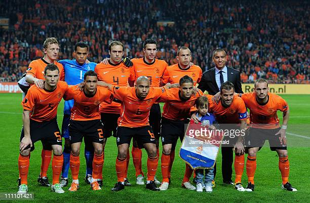The Netherlands team pose for a team photograph during the Group E EURO 2012 Qualifier between Netherlands and Hungary at the Amsterdam Arena on...