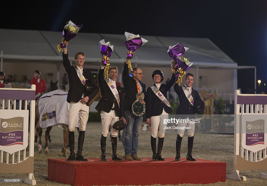 The Netherlands team poses on the winners podium after winning the President of the UAE Showjumping Cup - Furusyiah Nations Cup Series presented by Longines on February 21, 2013 in Al Ain, United Arab Emirates.
