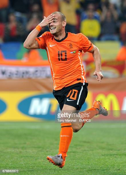 The Netherland's Wesley Sneijder celebrates scoring his side's second goal of the game