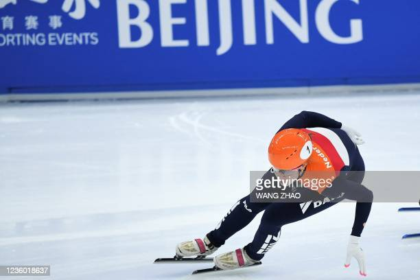 The Netherlands's Suzanne Schulting competes in the women's 1500m quarter-finals during the 2021/2022 ISU World Cup short track speed skating, part...