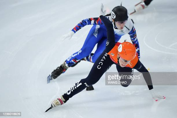 The Netherlands's Suzanne Schulting falls during the women's 1500m quarter-finals during the 2021/2022 ISU World Cup short track speed skating, part...