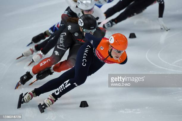 The Netherlands's Suzanne Schulting leads during the women's 1500m quarter-finals during the 2021/2022 ISU World Cup short track speed skating, part...