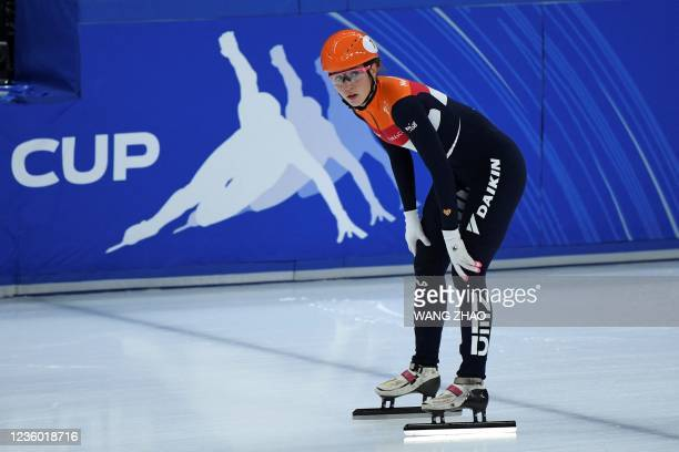 The Netherlands's Suzanne Schulting reacts after competing in the women's 1500m quarter-finals during the 2021/2022 ISU World Cup short track speed...
