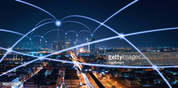 the network of city in dubai,uae - wireless technology fotografías e imágenes de stock
