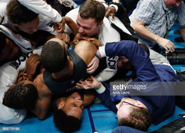 The Nevada Wolf Pack celebrate after defeating the Cincinnati Bearcats in the second round of the 2018 Men's NCAA Basketball Tournament at...