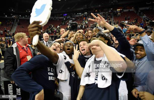 The Nevada Wolf Pack celebrates their team's victory over the Colorado State Rams in the championship game of the Mountain West Conference basketball...