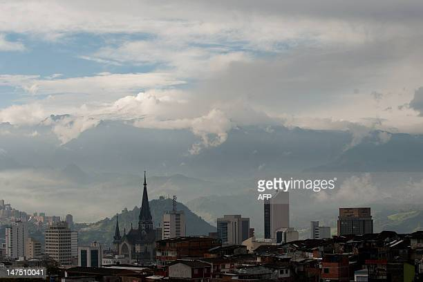 The Nevado del Ruiz volcano spews ash and smoke into the cloudy sky on July 1 in Manizales department of Caldas Colombia Authorities had ordered the...