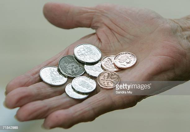The new 10 20 and 50 cent pieces which began circulation for the first time today sit in the palm of a hand July 31 2006 in Auckland New Zealand From...