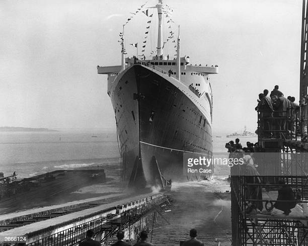 The new 1035foot French liner France the world's longest liner slides down the slipway on the day of her launch from the Chantiers de l'Atlantique...