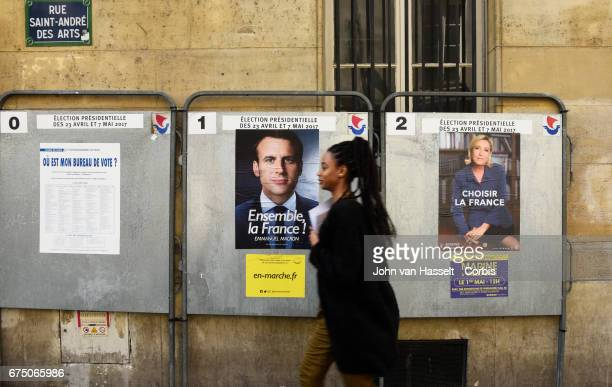 The new 2017 official presidential election posters of the remaining two candidates centrist Emmanuel Macron of the En Marche movement and farright...