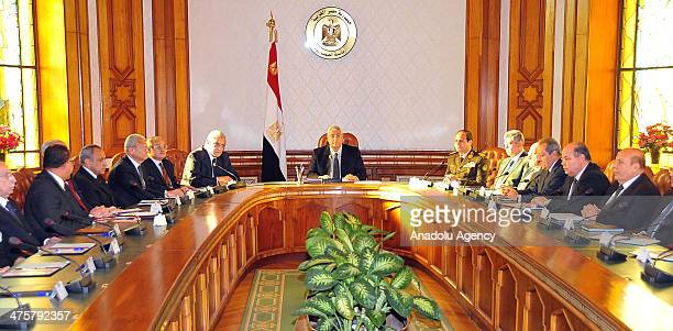 The new 31 ministers of Egypt's new government under Prime Minister Ibrahim Mehleb take the oath of office before interim President Adly Mansour in...