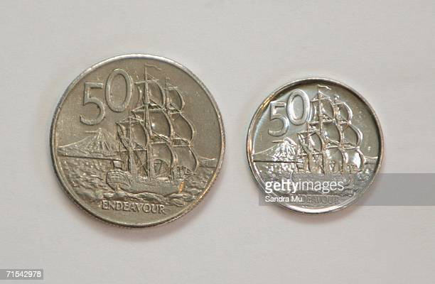The new 50 cent piece which began circulation for the first time today sits next to the older larger coin July 31 2006 in Auckland New Zealand From...