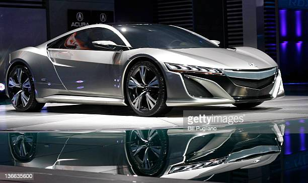 The new Acura NSX Concept vehicle is revealed during a media preview at the 2012 North American International Auto Show January 9, 2012 in Detroit,...