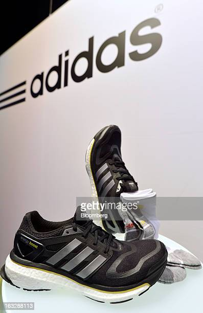 The new Adidas Energy Boost running shoe from Adidas AG is seen on display during the company's earnings news conference in Herzogenaurach Germany on...