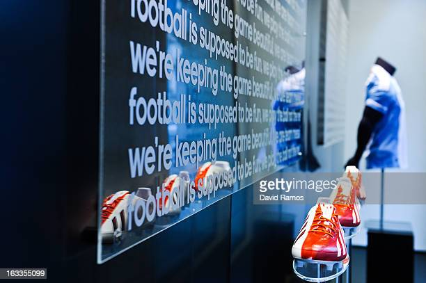 The new adizero f50 Messi boots are displayed at the window display of the new adidas Messi Gallery on March 6 2013 in Barcelona Spain