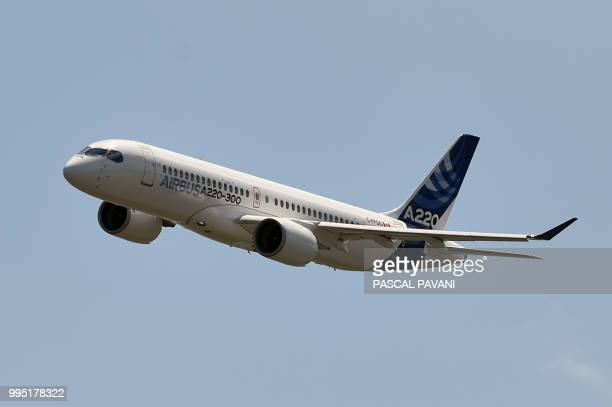 The new Airbus A220300 flies for the first time on July 10 2018 at the Airbus delivery center in Colomiers southwestern France