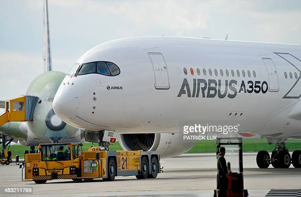 The new Airbus A350 XWB stands in front of an A380 on the production premisses of the European aircraft manufacturing company Airbus in Hamburg...