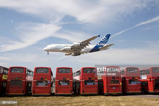 The new Airbus A380 double deck airliner comes in to land over a number of double deck busses after a short display flight during the Farnborough...