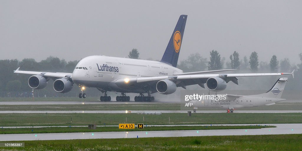 The new airplane Airbus A380 of the German airline Lufthansa lands for the first time at the Franz-Josef-Strauss airport in Munich on June 2, 2010. The A380 currently tours German airports practicing landing and take-off.