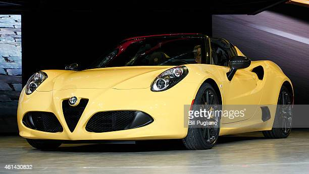 The new Alfa Romeo 4C Spider convertible is revealed to the media at the 2015 North American International Auto Show on January 12 2015 in Detroit...