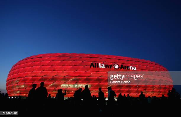 The new Allianz Arena football stadium is illuminated during an exhibition match between the traditional teams of 1860 Munich and Bayern Munich on...