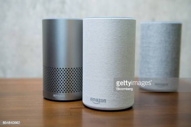 The new Amazoncom Inc Echo devices sit on display during the company's product reveal launch event in downtown Seattle Washington US on Wednesday...