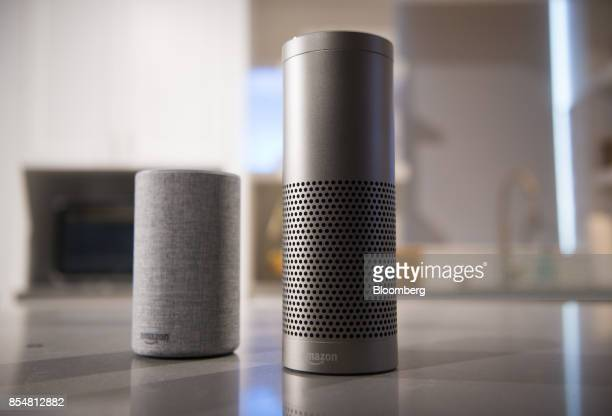 The new Amazoncom Inc Echo left and Echo Plus sit on display during the company's product reveal launch event in downtown Seattle Washington US on...