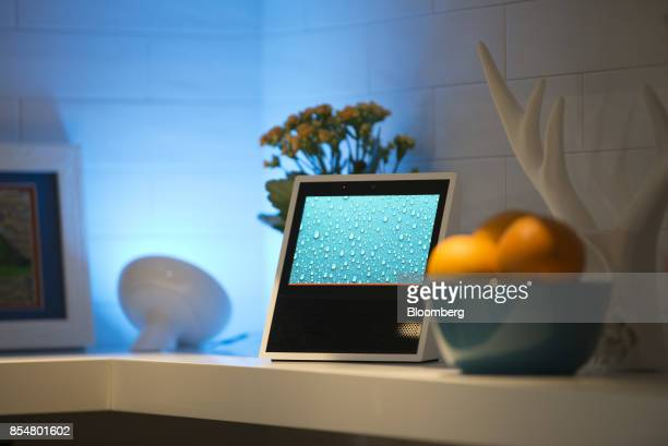 The new Amazoncom Inc Echo Show sits on display during the company's product reveal launch event in downtown Seattle Washington US on Wednesday Sept...