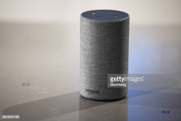 The new Amazoncom Inc Echo sits on display during the company's product reveal launch event in downtown Seattle Washington US on Wednesday Sept 27...