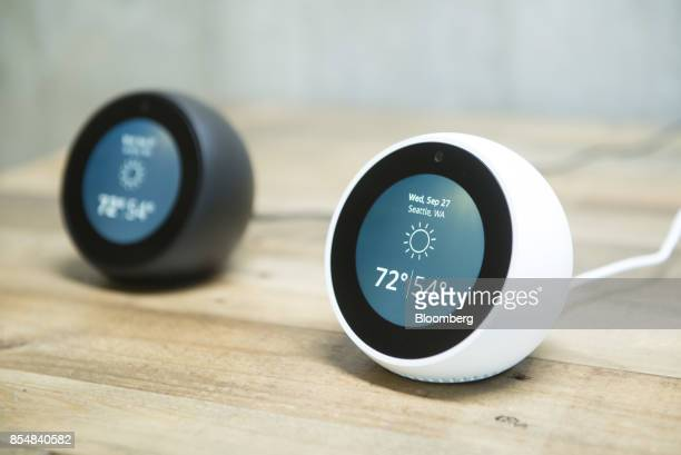 The new Amazoncom Inc Echo Spot devices sit on display during the company's product reveal launch event in downtown Seattle Washington US on...