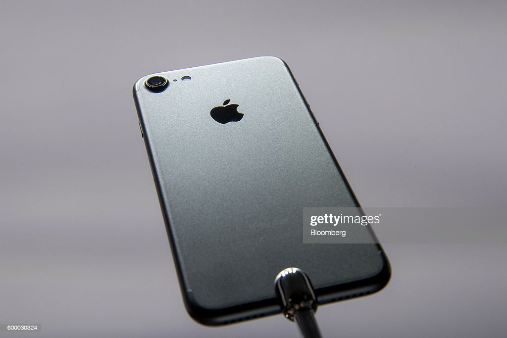 The new Apple Inc. iPhone 7 is displayed during an event in San Francisco, California, U.S., on Wednesday, Sept. 7, 2016. Apple Inc. unveiled new iPhone models Wednesday, featuring a water-resistant design, upgraded camera system and faster processor, betting that after six annual iterations it can still make improvements enticing enough to lure buyers to their next upgrade. Photographer: David Paul Morris/Bloomberg via Getty Images