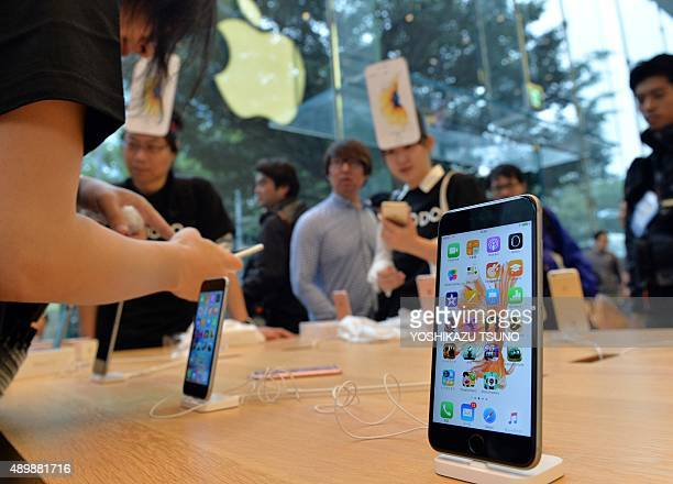 The new Apple iPhone 6s Plus is displayed at the flagship store in Tokyo on September 25 2015 Apple launched the new iPhone 6s and iPhone 6s Plus on...