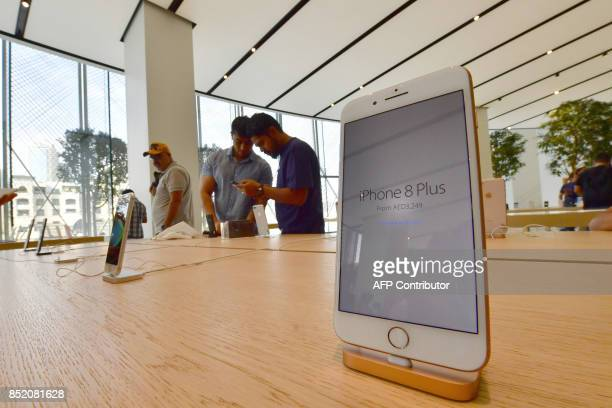 The new Apple iPhone 8 is on display at Dubai Mall Apple Store in Dubai on September 23 2017 The new Apple iPhone 8 and 8 Plus as well as the updated...