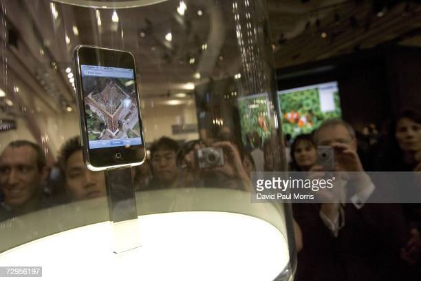 The new Apple iPhone is displayed at Macworld January 9 2007 in San Francisco California The new iPhone will combine a mobile phone a widescreen iPod...