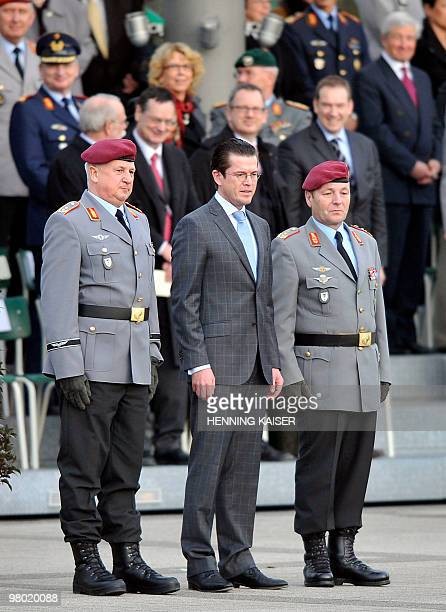 The new army inspector major general Werner Freers German Defence Minister KarlTheodor zu Guttenberg and Chief of German Army Lt Gen and parting army...
