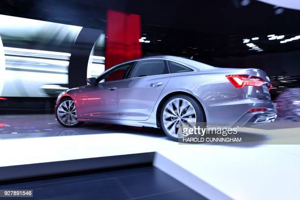 The new Audi A6 is displayed at the car maker's booth during a press day ahead of the Geneva International Motor Show on March 6 2018 in Geneva The...